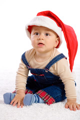 One year old baby boy in santa's hat.