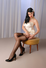Retro fifties pin-up girl in vintage lingerie