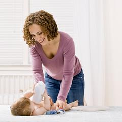 Devoted mother change her sonÕs diaper