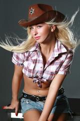 Beautiful rodeo girl wearing a cowboy hat