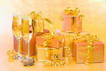 Decoration with gift boxes and champagne glasses