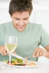 Young Man Enjoying meal,mealtime With A Glass Of Wine