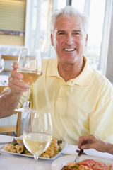 Man Enjoying meal,mealtime With A Glass Of Wine