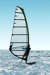 Windsurfer on waves of a sea