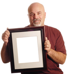 bald man holding picture frame