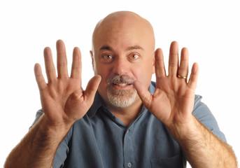 bald man holding up hands gesturing stop