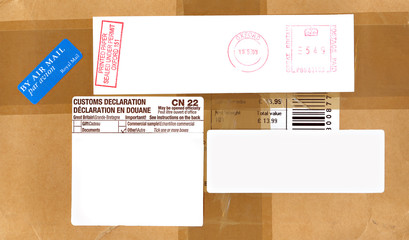 Airmail, postage and customs labels on a package from England.