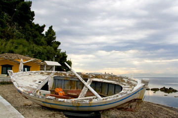 Old wreckage of a traditional greek fishing boat