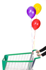 Woman hands push shopping trolley with  helium ballons