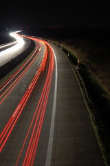 highway at night with car traffic and lights