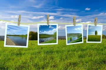 Landscape photographs hanging on a clothesline