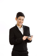 Happy businesswoman using mobile phone, smiling,