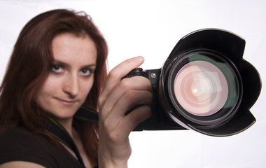 young photographer with digital camera isolated on white.