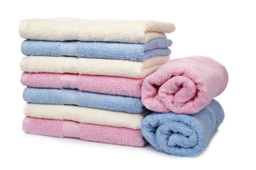 Multicolored towels stacked with soft shadow on white background