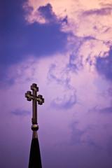 cross on cloudy purple sky