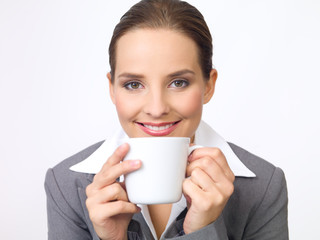 Portrait of beautiful and young business woman with coffee cup