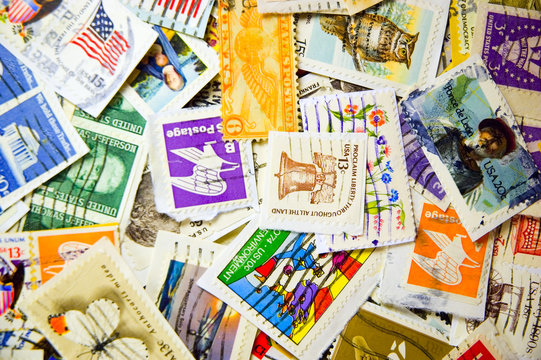 A collection of U.S. stamps in a pile