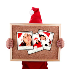 santa woman holding billboard with christmas photos