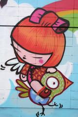 niña volando sobre un pajaro. graffiti manga
