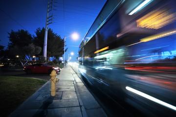 Fotobehang - Speeding bus, blurred motion. Las Vegas Blvd., Las Vegas, USA.