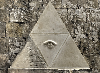 Eye of Providence symbol etched in limestone