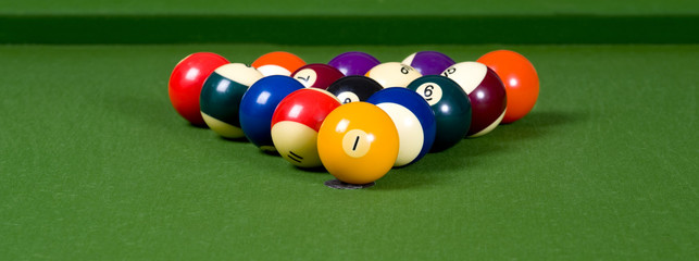 A game of pool with the balls lined up in an 8-ball formation