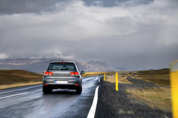 Aluminium Prints Landscapes A new car driving fast on a road in a countryside