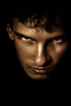 Close up face portrait of evil sinister spooky man