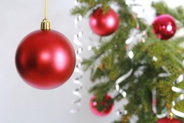 Red Christmas Ball on Pine Branch isolated