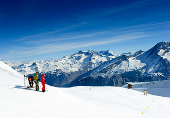 Skiers on the top of the mountain in Meribel Valley