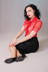 Retro fifties pinup attractive girl in red polka-dot blouse