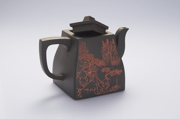 Chinese teapot on the white background