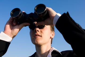 Man with binocular, focus on face