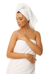 Portrait of 20-25 years old beautiful woman wearing towel
