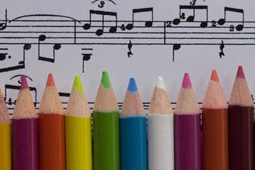 color pencils on music score