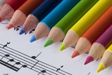 color pencils and sheet music