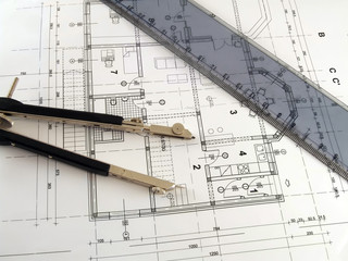 dividers and ruler laying on architectural plan