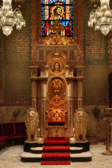 Bishop's chair in catheral with lion statues