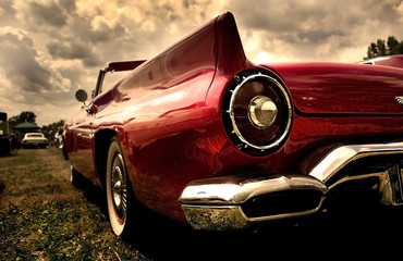 Wall Murals Old cars Close up shot of a vintage car in sepia color tone