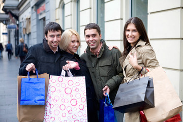 a group of young people doing shopping at the city center