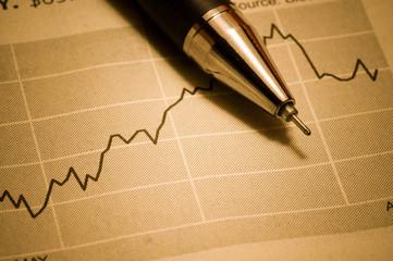 Business concept: pen and diagram