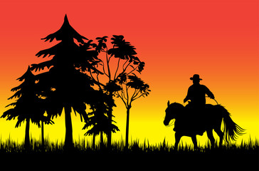 Cowboy on a horse over sunset