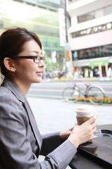 businesswoman takes a rest in a cafe
