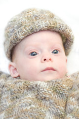 Newborn baby in winter clothes