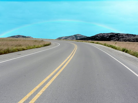 a road going through the Wichita Mountains of Oklahoma