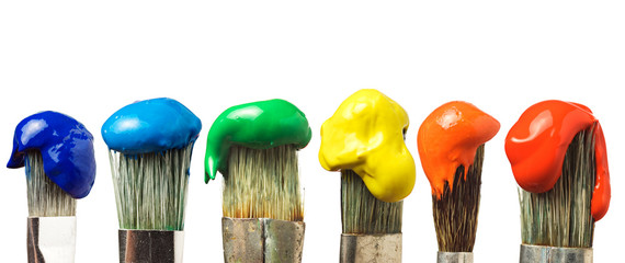 Six brushes with paint