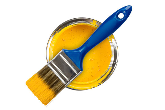 Yellow paint can with brush isolated on a white background
