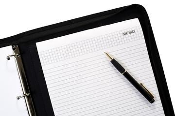 ballpen on notepad inside ring-binder isolated