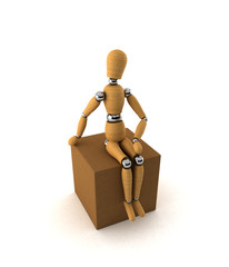 Wooden mannequin sitting on moving box over white