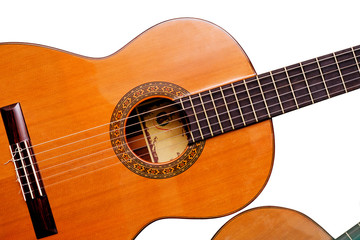 Acoustic guitar close-up isolated on white background